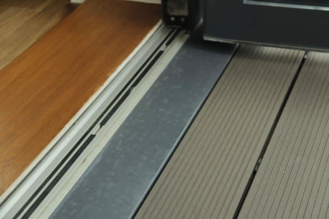 level balcony threshold showing close up of door sill interface