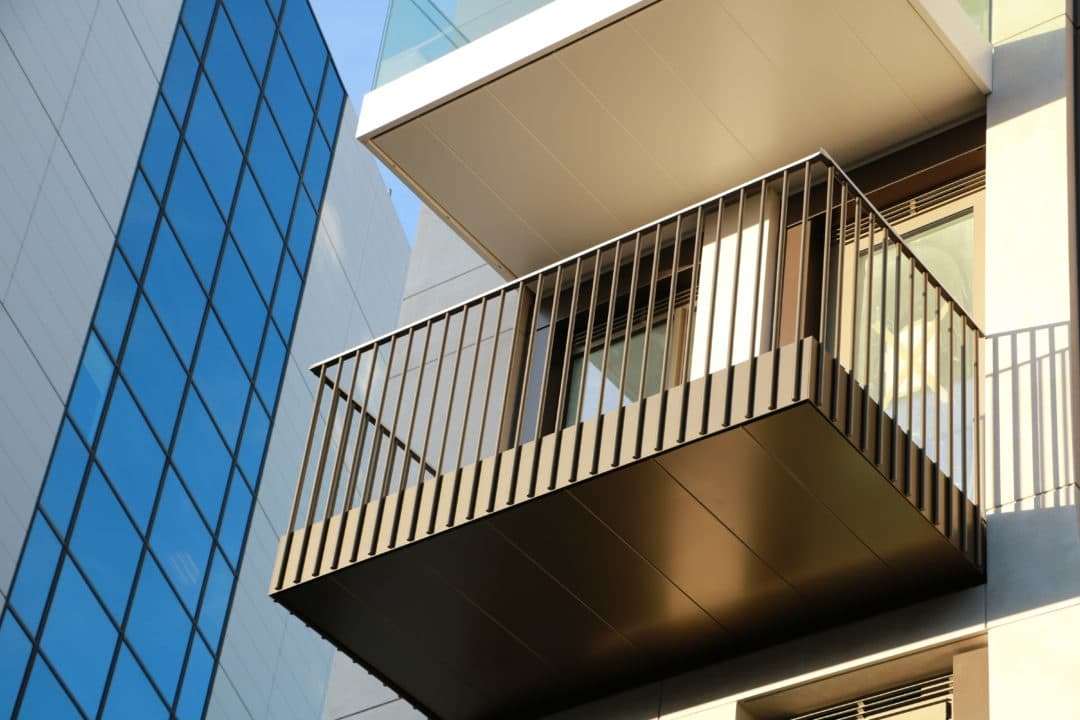 Vertical bar balustrades made with round stainless steel bar. Round bars forming modern looking railing solution