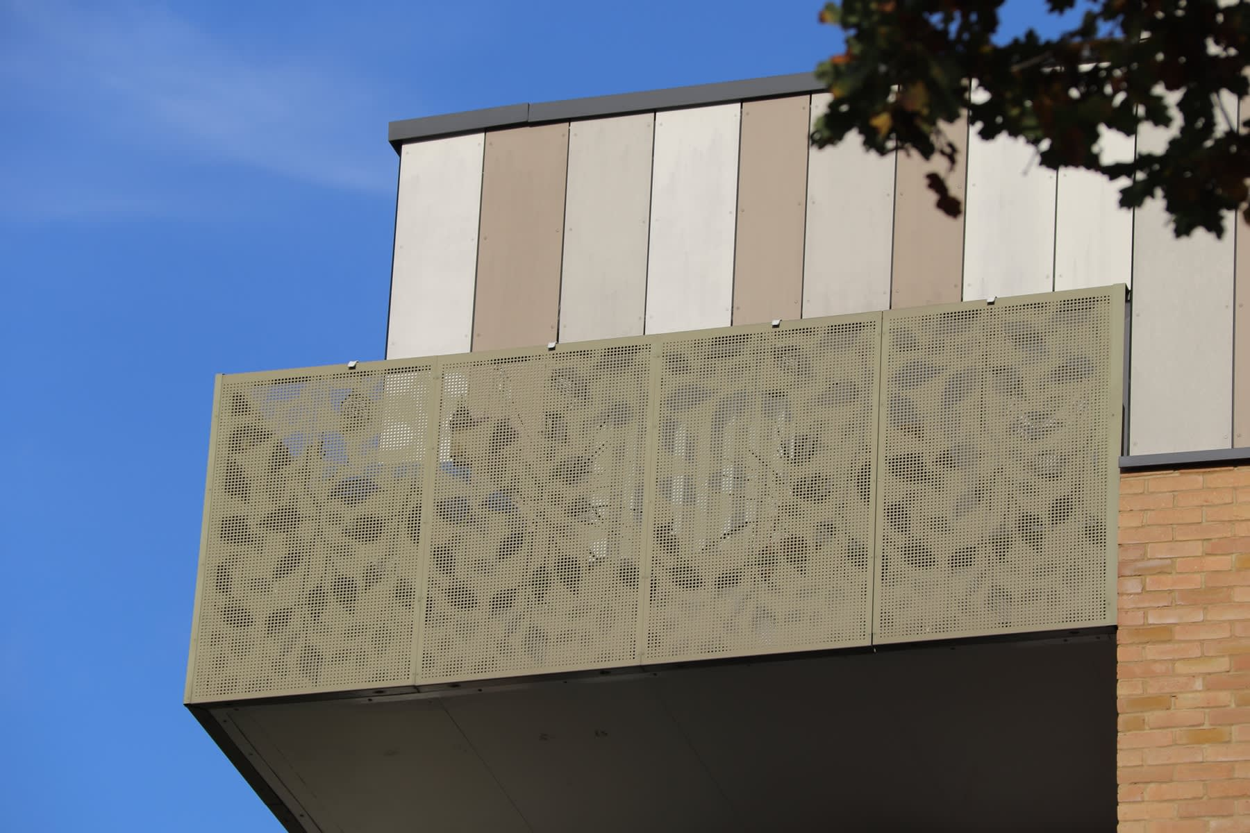 balconies with perforated balustrade panels in powder coated aluminium